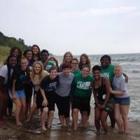 Group picture on the beach of all the women ant the women's leadership house